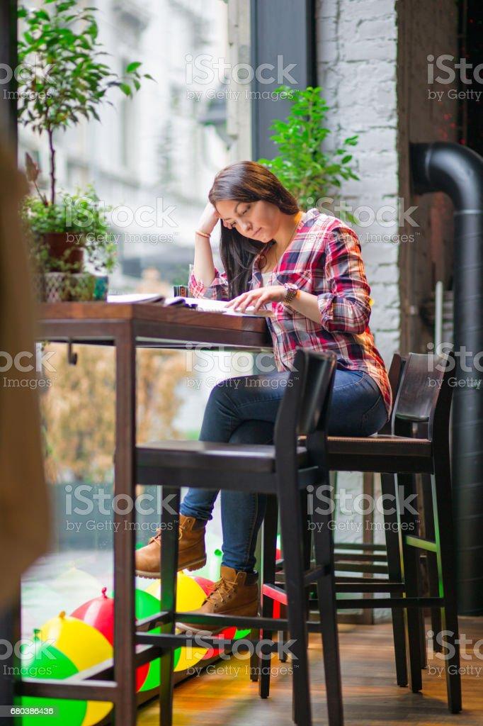 Cute girl enjoy a coffee break royalty-free stock photo