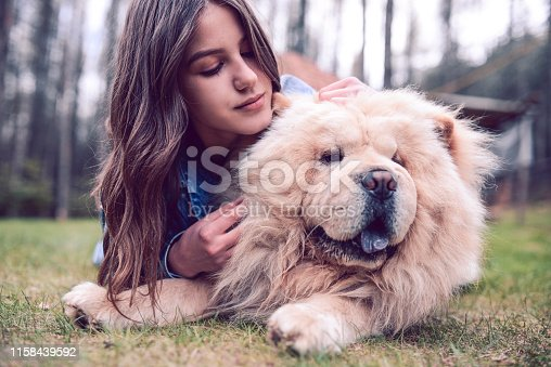 Cute Girl Enjoying Picnic Time With Her Cute Dog