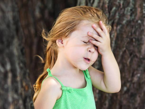 Cute girl facepalming forgetting something Cute little curly hair blonde girl facepalming forgetting something head in hands stock pictures, royalty-free photos & images