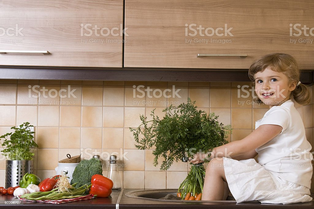Cute girl helping in kitchen royalty-free stock photo