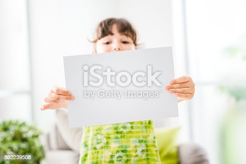 istock Cute girl holding a sign 862239508
