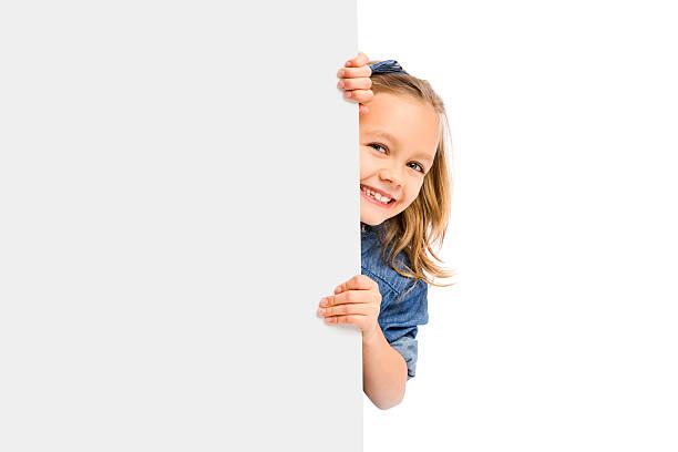 cute girl holding a whiteboard - peeping tom stock-fotos und bilder