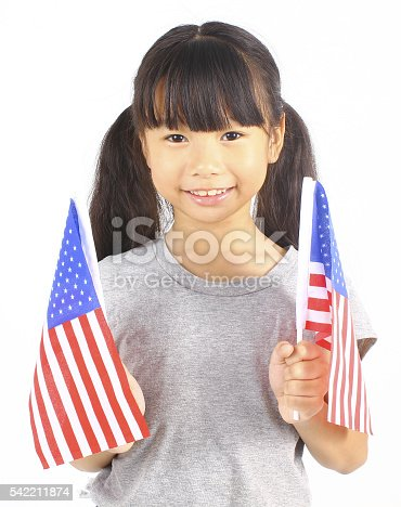 539482224 istock photo Cute girl holding an American Flag isolated 542211874
