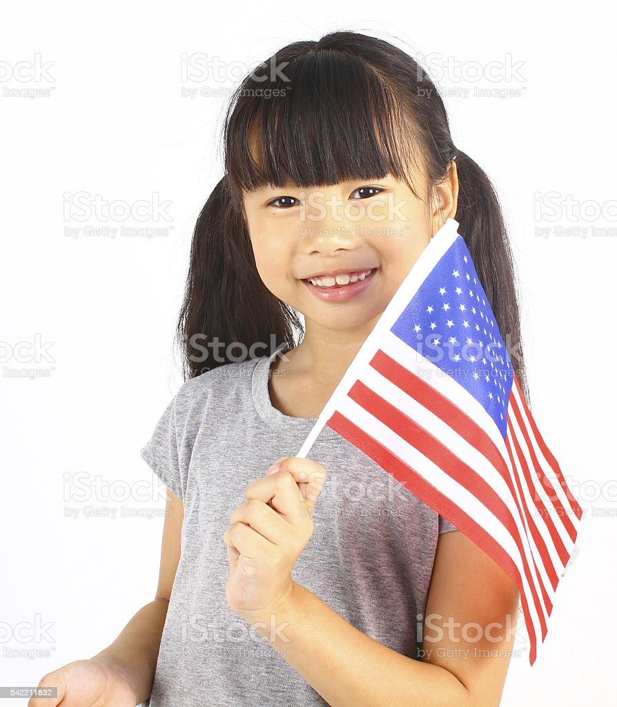 Cute girl holding an American Flag stock photo