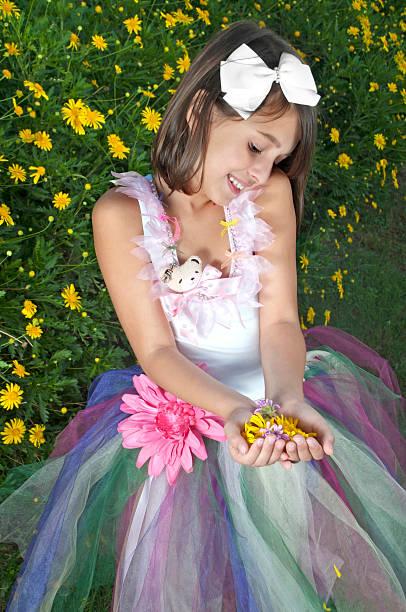 Cute girl holding daisies stock photo