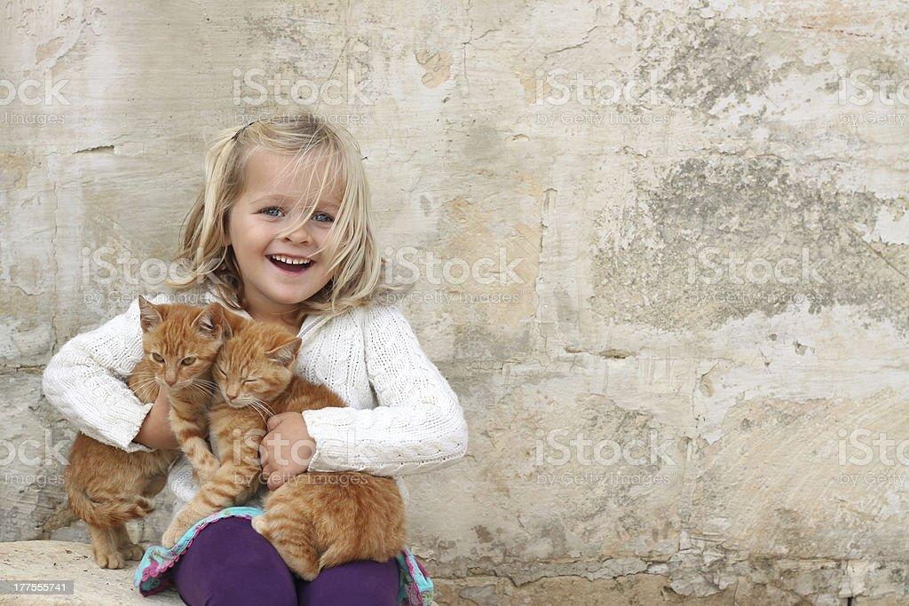 Cute girl holding kittens stock photo
