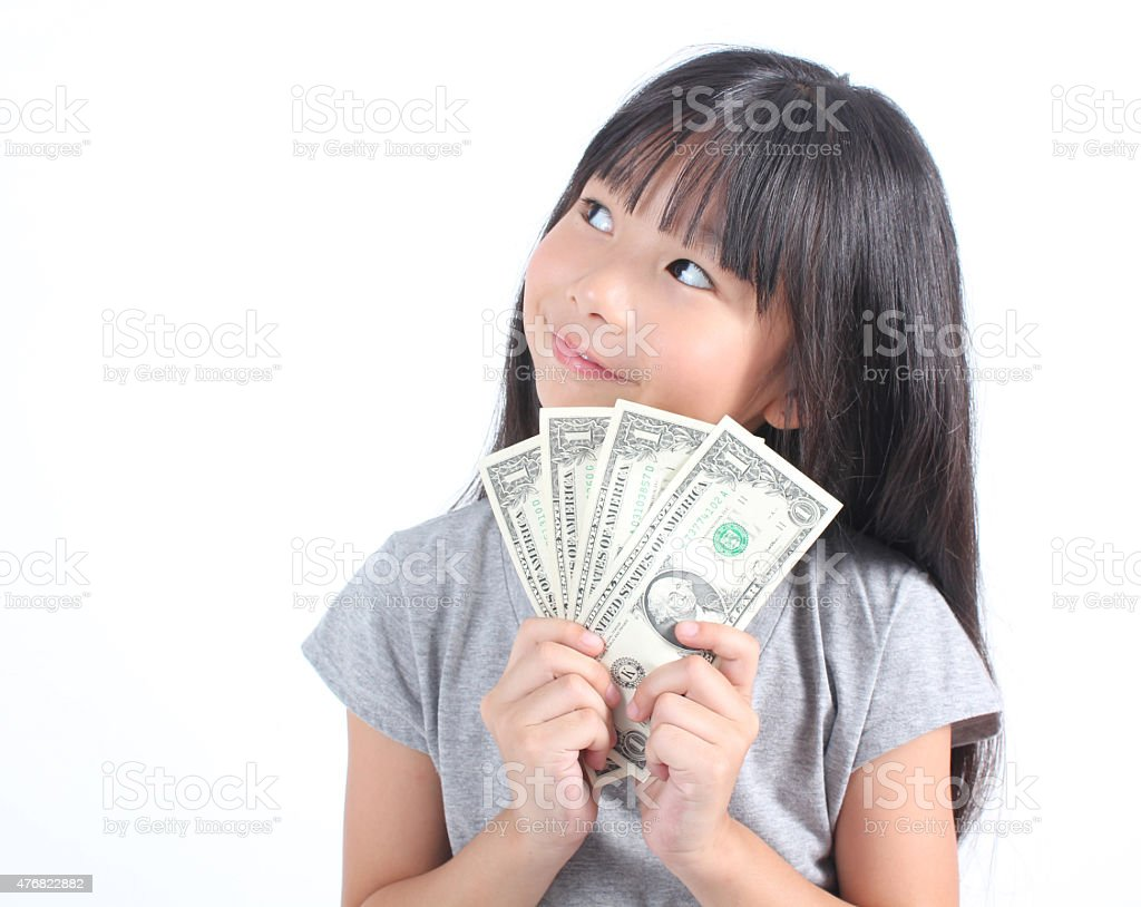 Cute girl holding money stock photo