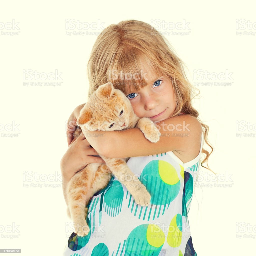 Cute girl hugging a little cat isolated on white background - Photo