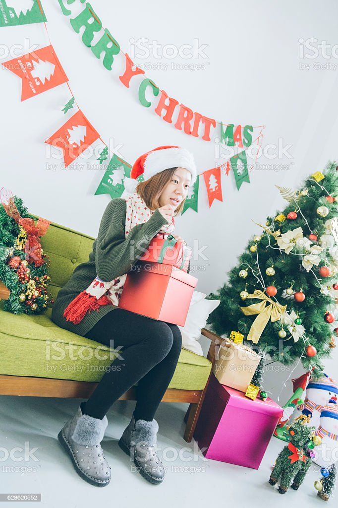 Cute Christmas Gifts For Girlfriend.Cute Girl Hugging Christmas Gifts On Sofa Stock Photo More