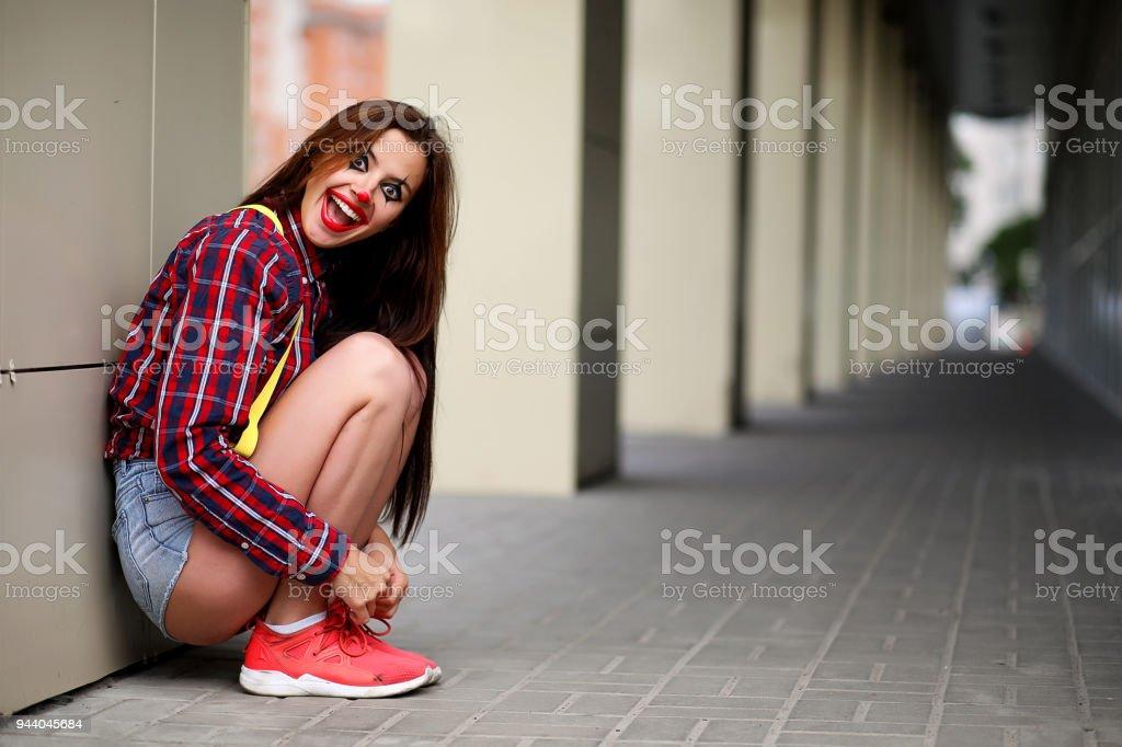 Jolie fille dans un maquillage de clown - Photo