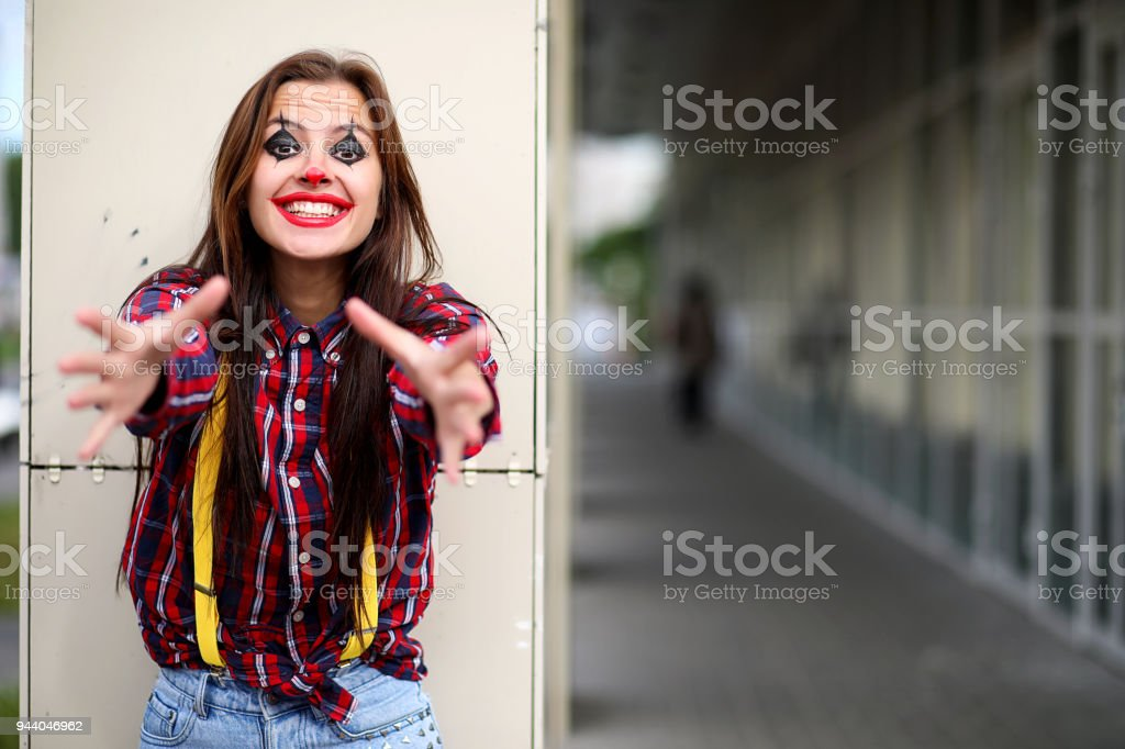 Cute girl in a clown makeup - Stock image .