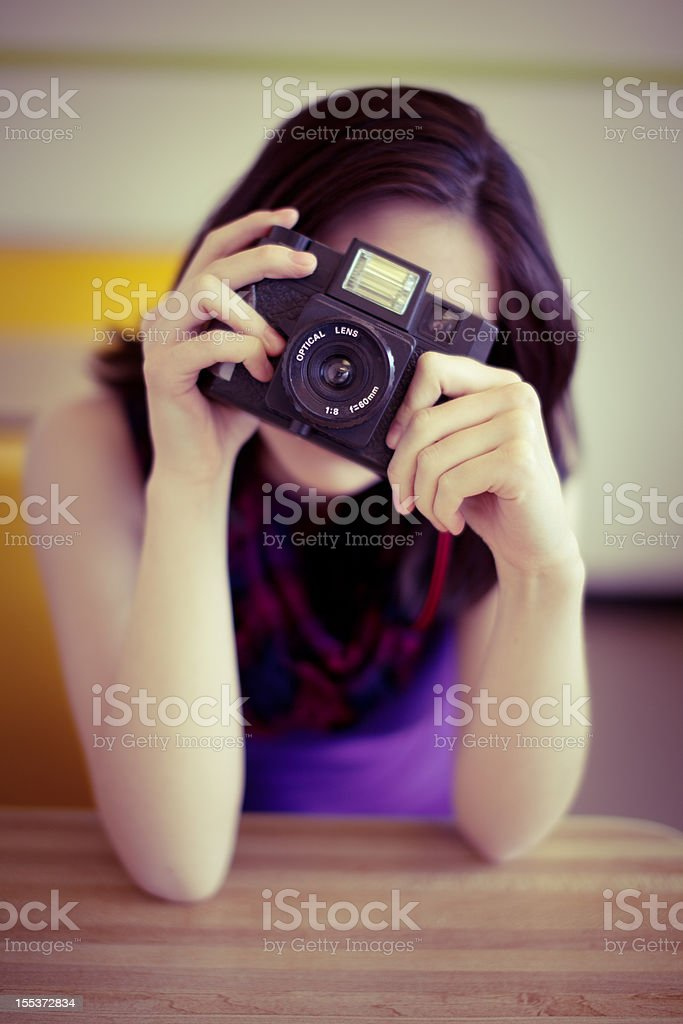 Cute girl in a donut shop royalty-free stock photo