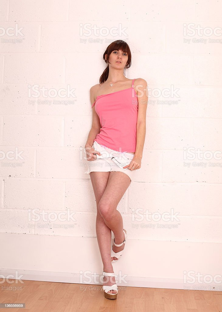 Cute girl in a pink top stock photo