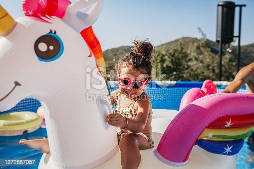 Cute girl in a swimming pool