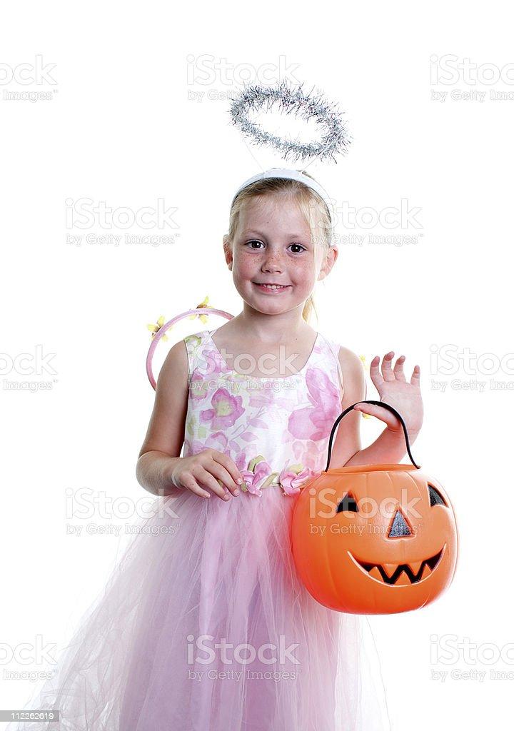 Cute  Girl in Angel  Halloween Costume and Jack O' Lantern royalty-free stock photo