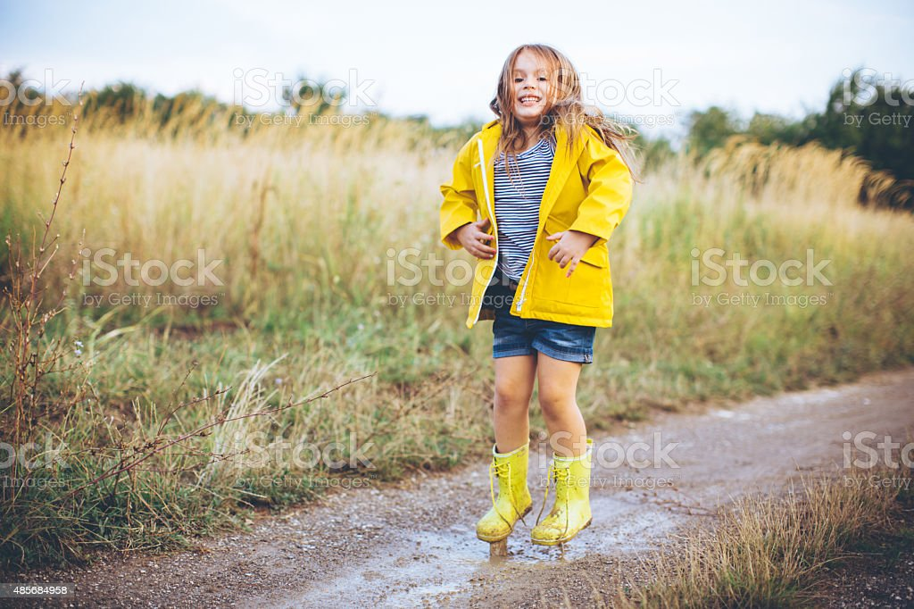 Cute girl in countryside. stock photo