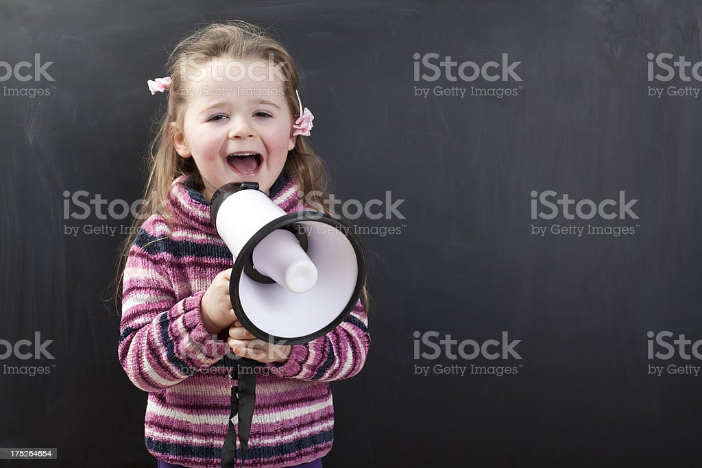Cute girl in front of a chalkboard royalty-free stock photo