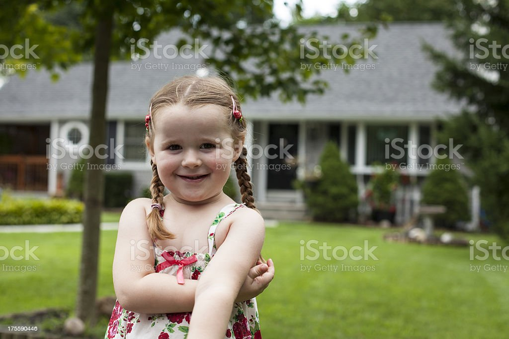 Cute girl in front of an american house royalty-free stock photo