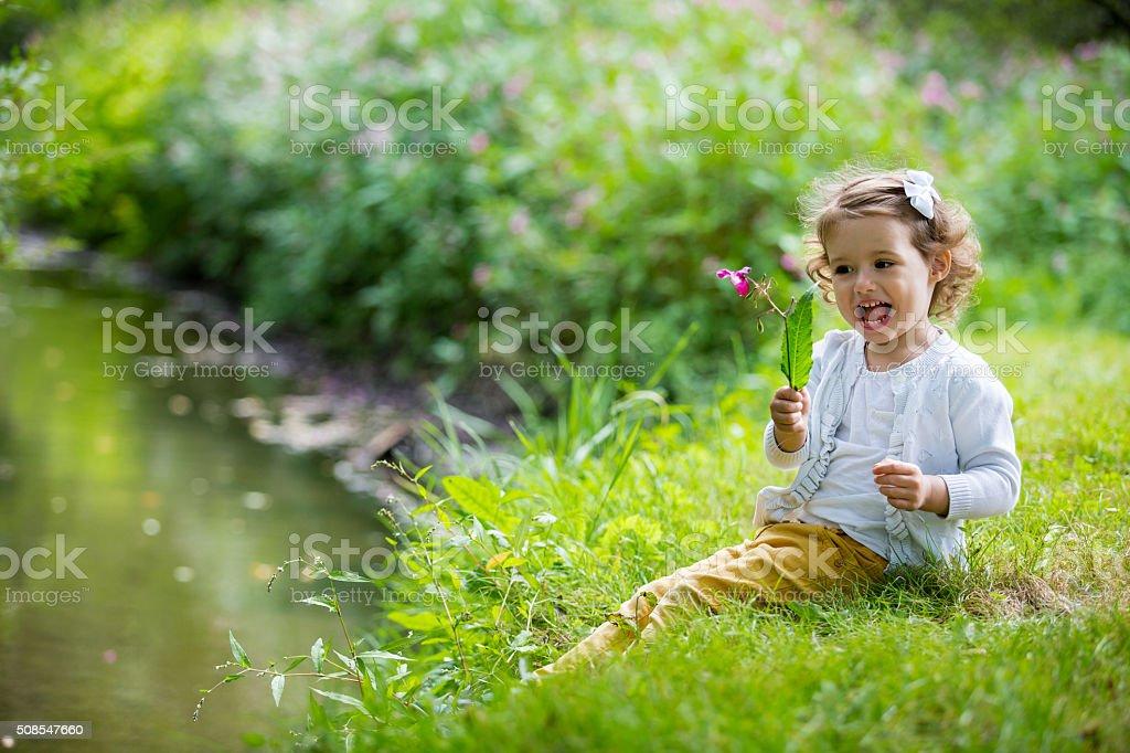 Cute girl in park stock photo