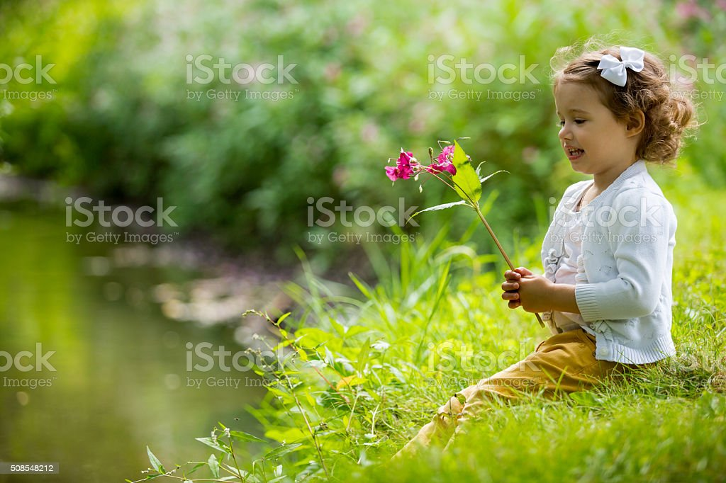 Cute girl in park stock photo