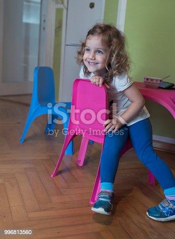 678589610istockphoto Cute girl in room 996813560