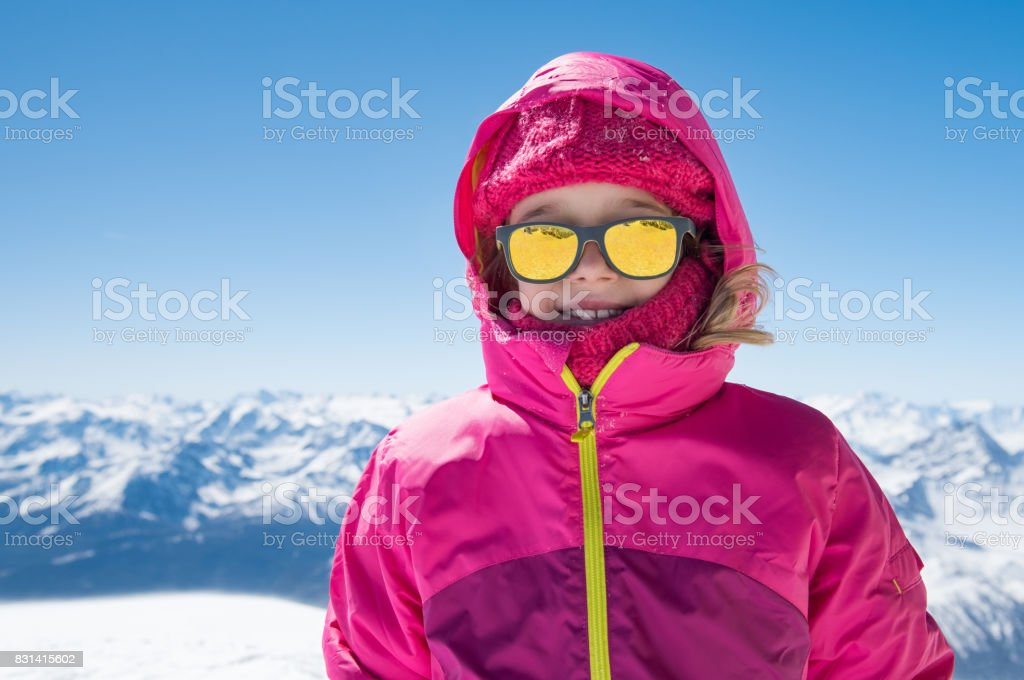Cute girl in snowy mountain stock photo