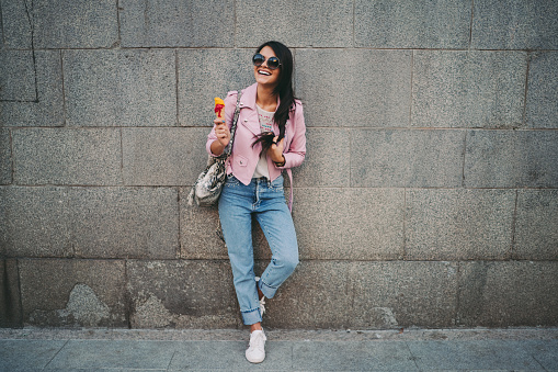Cute girl in the city eating ice-cream