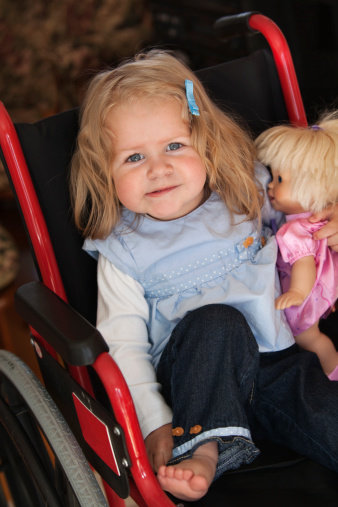 Blue eyed girl and her dolly sitting in wheel chair. For more images from this session please click on lightbox below...