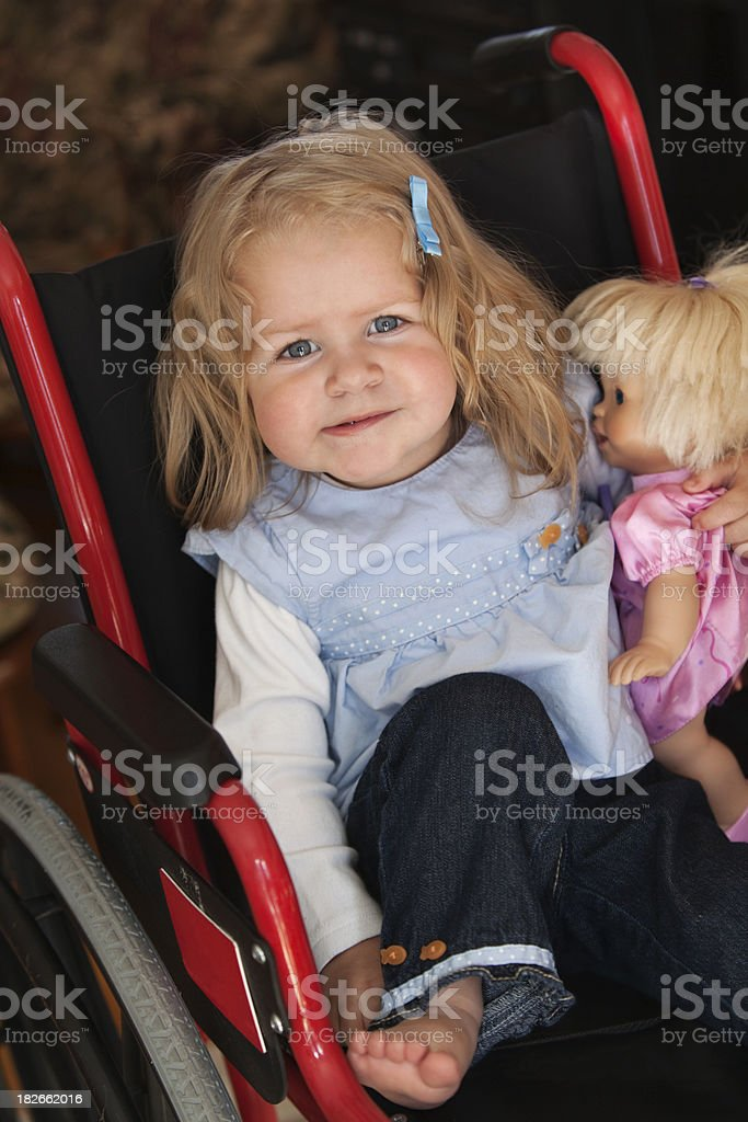 Cute Girl in Wheel Chair stock photo