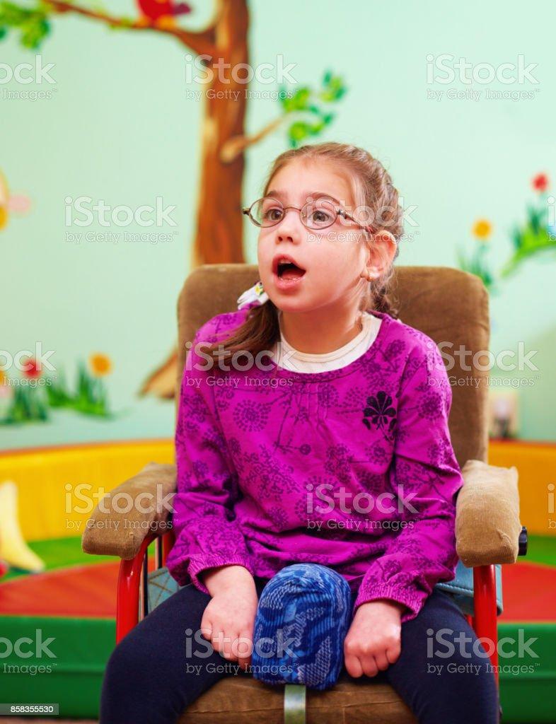 cute girl in wheelchair in kindergarten for children with special needs - foto stock