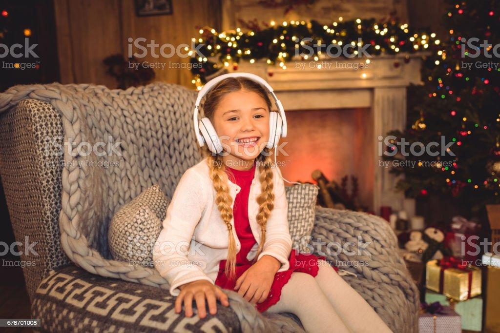 Cute girl in white headphones photo libre de droits