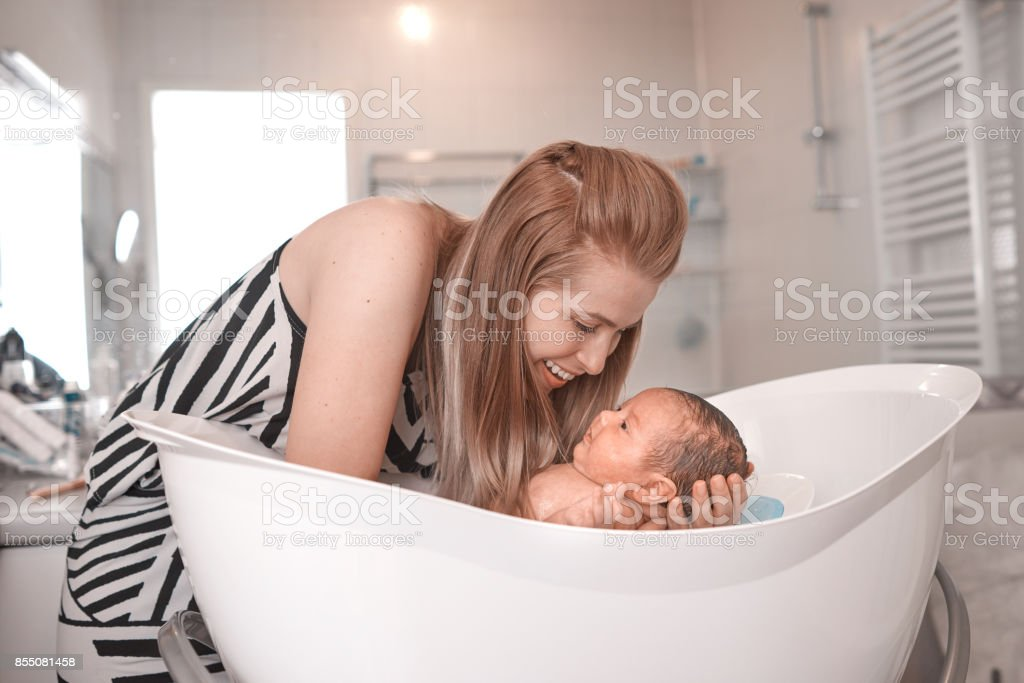 cute girl inside bathtub stock photo