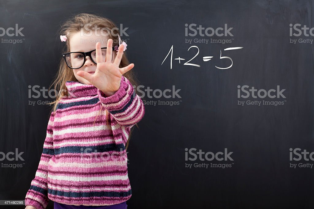 Cute girl is doing wrong maths stock photo