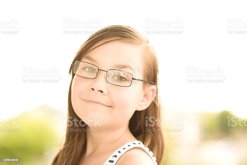 Cute girl is holding her face in astonishment stock photo