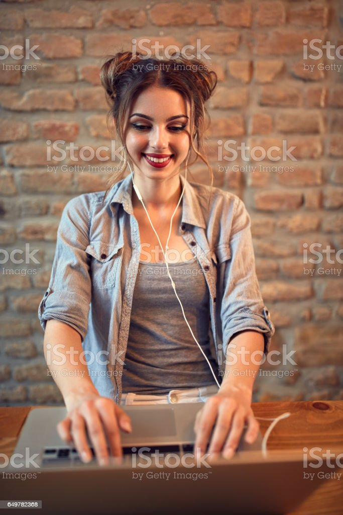 Cute girl learns from laptop stock photo