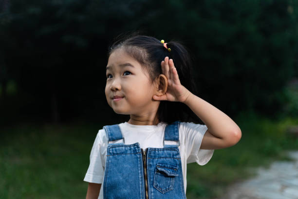 Cute Girl Listening Cute Girl Listening hands covering ears stock pictures, royalty-free photos & images