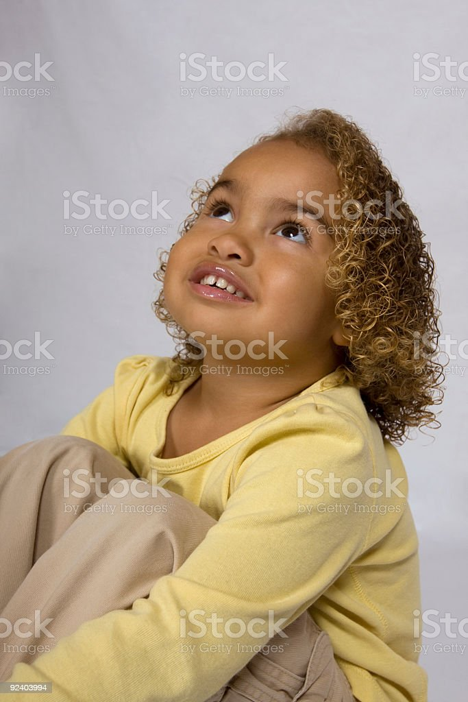 Cute girl looking up in the air stock photo