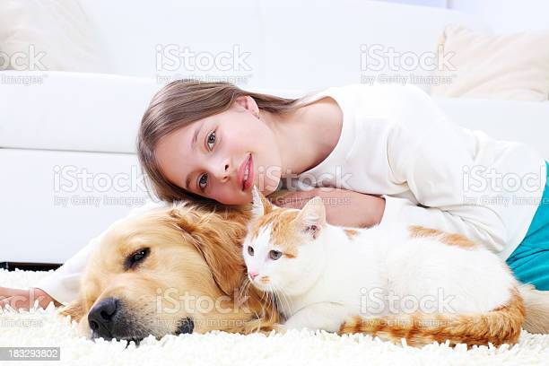 Cute girl lying on the white carpet with pets picture id183293802?b=1&k=6&m=183293802&s=612x612&h=vnierzbtrdwrk8orwtefwkz9sz2osr4wpl02gafz8a8=