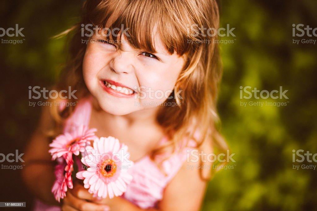 Cute girl making a funny face at camera royalty-free stock photo