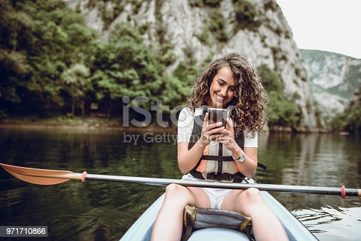 Cute Girl Making Taking Selfie During Lake Kayaking Trip