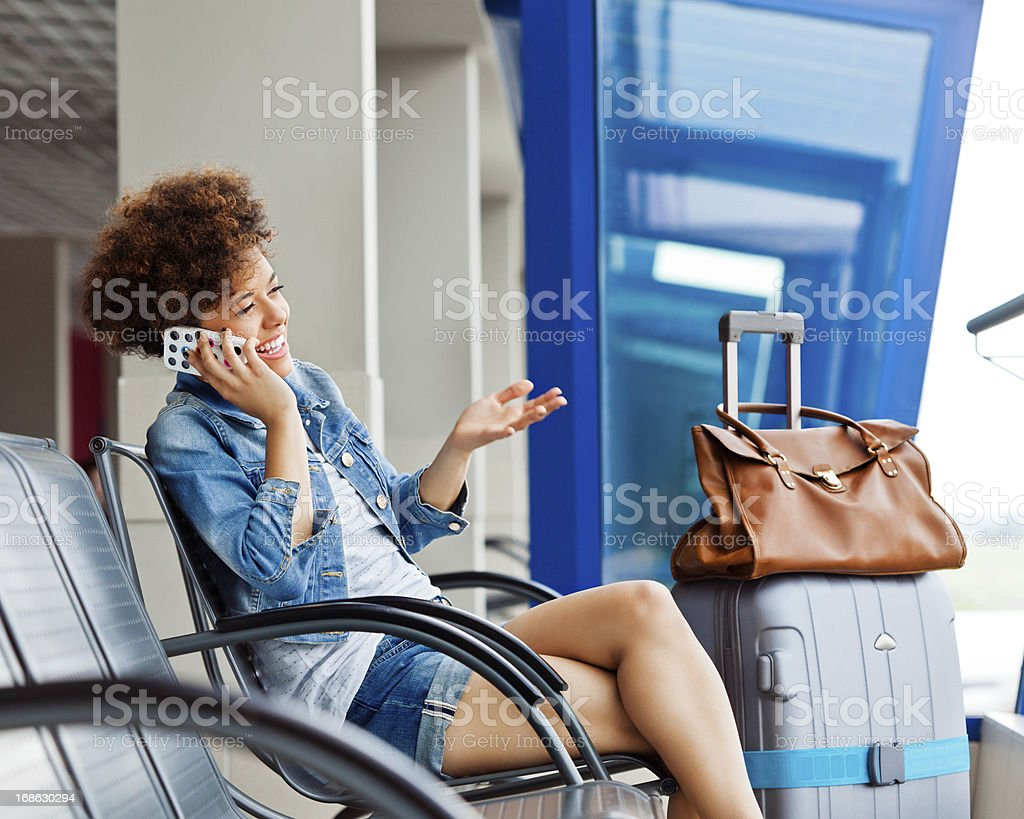 Cute girl on phone at the airport royalty-free stock photo
