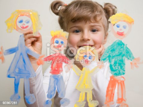 123499844istockphoto Cute girl painting family 92367281