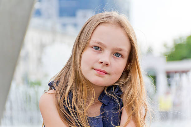 Cute girl Portrait of cute girl with blond hair 8 9 years stock pictures, royalty-free photos & images