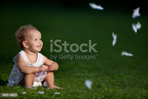 Girl and white feathers in the park
