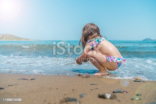 Cute girl playing on the beach