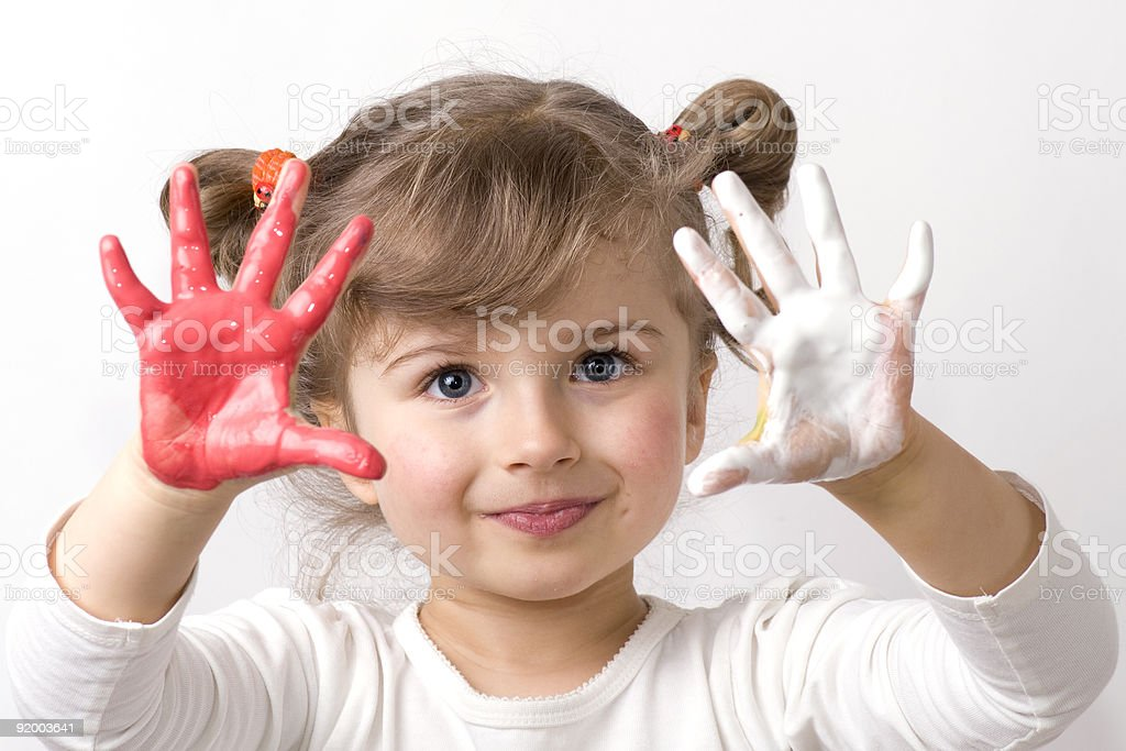 Cute girl playing with colors royalty-free stock photo
