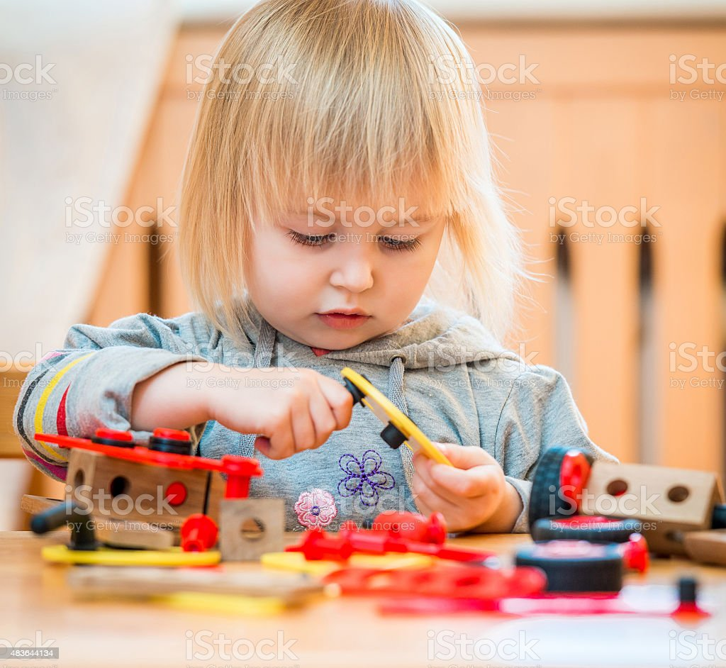 cute girl playing with constructor stock photo