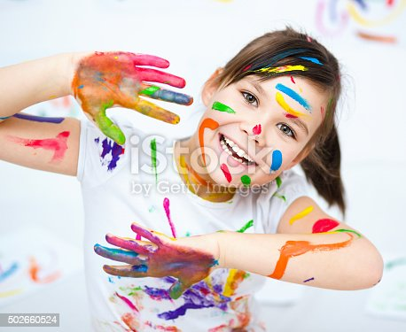 istock Cute girl playing with paints 502660524