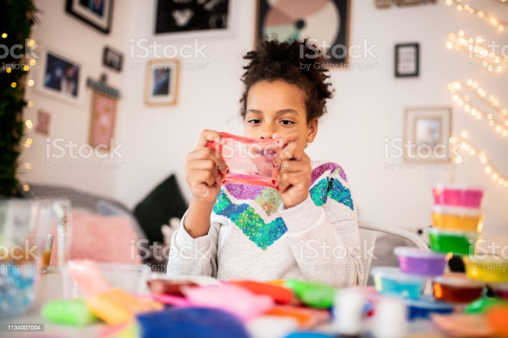 Cute girl playing with slime Little Girl Vlogging 10-11 Years Stock Photo