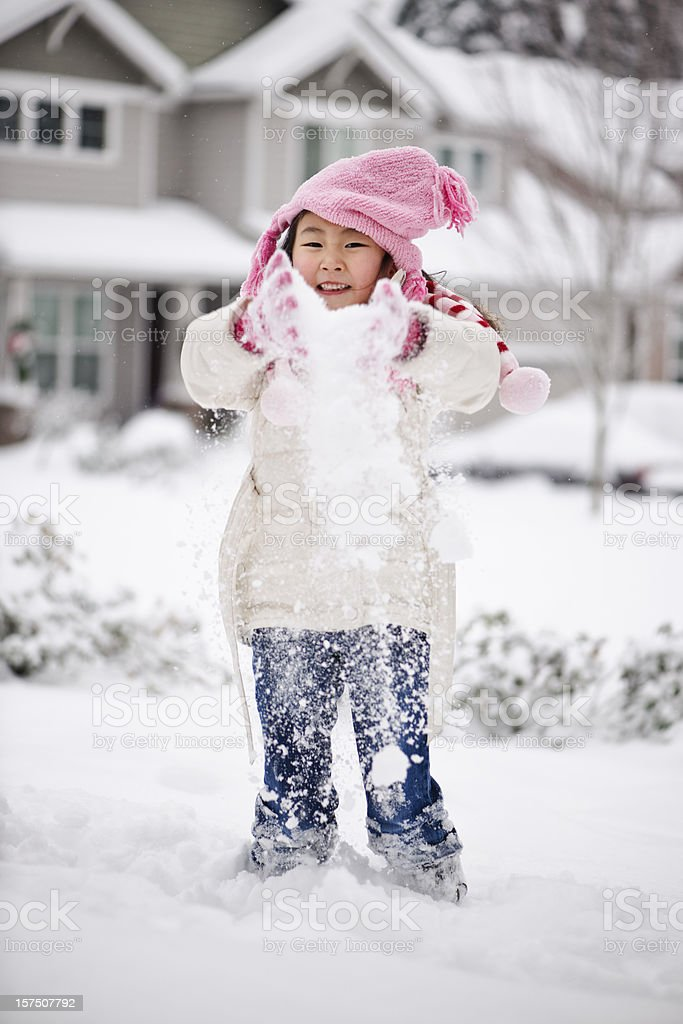 Cute girl playing with snow royalty-free stock photo